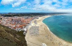 An Elevated View Over Nazaré Beach Portugal Heneedsfood