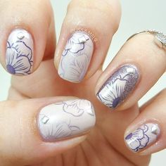 White nails with purple and silver flowers