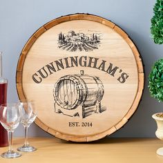 What's more fun than a barrel of vino? Why a customized sign made from the face of an actual vino barrel, of course!