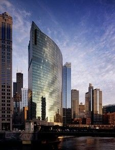 This dramatically curved, green-glass tower at the fork of the Chicago River houses the corporate headquarters of 116-year old global asset manager, Nuveen Investments.