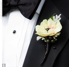 Joel looked dapper in a Ralph Lauren tux and bowtie. He also wore a white anemone blossom accented with deep purple berries and silvery, dusty miller foliage on his lapel.