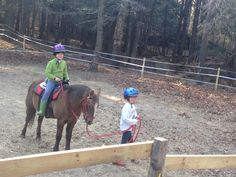 Emma giving Joey a riding lesson on Mickey Mouse