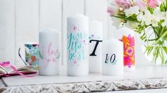 White candles with printed slogans | DIY transfer candle decorations | Tesco Living