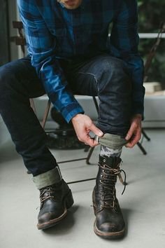 Consider pairing a dark blue check longsleeve shirt with black jeans for a trendy and easy going look. Black leather boots will bring a classic aesthetic to the ensemble.  Shop this look for $127:  http://lookastic.com/men/looks/navy-longsleeve-shirt-black-jeans-grey-socks-black-boots/3784  — Navy Plaid Longsleeve Shirt  — Black Jeans  — Grey Socks  — Black Leather Boots