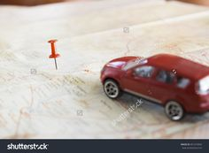 Travel Concept Background.Red Pushpin Push Point Of Location Destination On Map With Blur Red Car Stock Photo…
