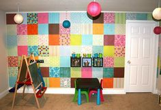 Love it! Just like a Quilt! supplies: Glue dots, $13 dollar scrapbook paper pad, creativity ; ) OH you can also cut them into circles to make polka dots on walls too!