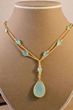 Amy Fine - gorgeous jewelry  C: Are those faceted opals?  That pale color is entrancing!  C:  Is it Smithsonite?