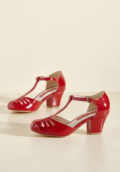 Shimmer Down Now T-Strap Heel in Cherry Gloss. Whoa there, lady thang, we know youre excited about these sleek red heels by B.A.I.T. #red #modcloth