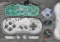 Deconstructed Video Game Controllers by Brandon Allen