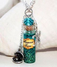 Mermaid Tears in Glass Bottle Potion Necklace with Starfish and Seashell charms from knaivelt10. Saved to Things I want as gifts.
