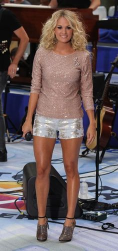 Carrie Underwood in an Alice + Olivia top (http://rstyle.me/h8q8qhnn4e), 7 For All Mankind Shorts (http://rstyle.me/hn6ym5nn4e), and B Brian Atwood booties (http://rstyle.me/n/caawnn4e).