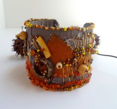 Fragments in brown mixed media cuff by Cesart64 on Etsy