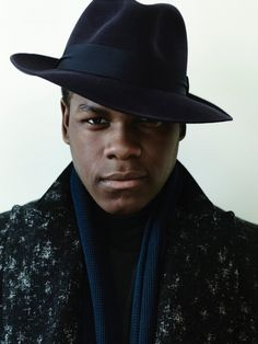 John Boyega photographed by Bryan Adams in a chic felt fedora hat.
