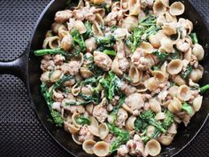 Pasta with broccoli rabe and sausage is an Italian classic. Our version gets all the flavor and texture of the real deal, all in a single skillet and under half an hour.