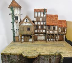 Behind the scenes- Making a Dungeons and Dragons town backdrop The release of two Baldur's Gate box sets, it gives me a great opportunity to show you the theory and evolution of creating a box cover backdrop. Fantasy Village, Fantasy Town, Fantasy House, Dungeons And Dragons Miniatures, Planet Coaster, Infinity The Game, Sims House Plans, Fantasy Model, Timber House