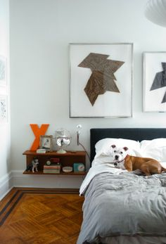 I don't like parquet floors, but these are nice. Nice bedside cabinets and pictures/headboard