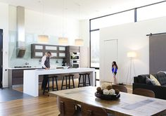 Modern kitchen with lighting by Flos