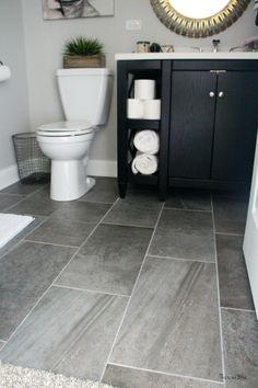 Basement bathroom reveal | gray porcelain tile floor | black vanity | neutral bathroom decor || This is our Bliss