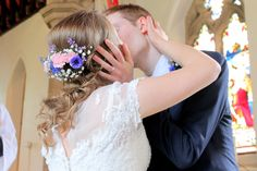 A lovely shot of the happy couple (and the fresh hair flowers!)  Photograph courtesy of Liz Ewbank http://raddingsphotography.wordpress.com/