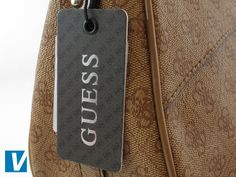 New Guess handbags feature a Guess branded swing tag. Guess have used a variety of tag colours and styles. The most common is a grey Gucci patterned tag, with rounded corners, and 'Guess' or 'Guess by Marciano' in silver. Note that real tags can be found attached to counterfeit handbags.