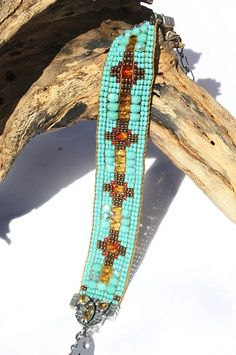 Chili Rose Magnificent Turquoise & Sunset Colored Beaded Gemtip Bracelet! http://www.cowgirlkim.com/chili-rose-extraordinary-black-rust-and-turquoise-beaded-bracelet-8929.html