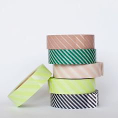 """Say goodbye to boring masking tape for good. Japanese washi tape is easy to tear, easy to remove and leaves no residue when you peel it off. This multi-purpose, durable masking tape comes in fun and elegant patterns, and has the unique transparency of rice paper. Perfect for adding the finishing touch to envelopes, gift packages or photo collages. Each pack includes 2 rolls of washi tape."" $9.00 Poketo.com"