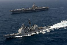 USS John C. Stennis and USS Mobile Bay at sea. by Official U.S. Navy Imagery, via Flickr