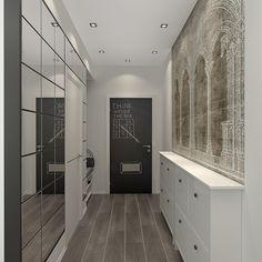 Прихожая также выполнена в белом цвете. Большое зеркало напротив стены визуально увеличивает пространство
