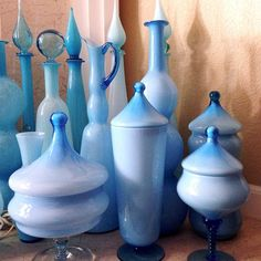 Baby blue Empoli Italian mid-century cased decanters, apothecary jars, and pitchers.