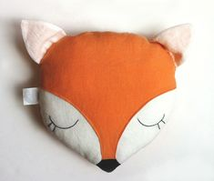 """Sleeping fox pillow. Face features are all hand embroidered. You can also ask to have a name hand embroidered on the back. Simply select the option with embroidered name.100% Certified Organic Linen, naturally dyed with no harsh chemicalsCorn Fiber filling, 100% Biodegradable10"""" W x 11"""" HAll Dolls"""