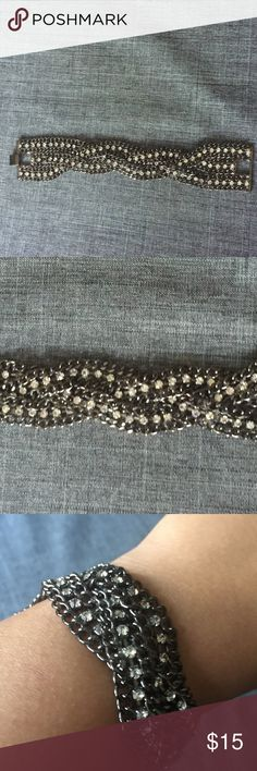 Braided Chain and Crystal Bracelet Beautiful braided chain bracelet with gem details. Dark silver with white stones. ~7 inches long with clasp closure. Used with love, in excellent condition. Xhilaration Jewelry Bracelets