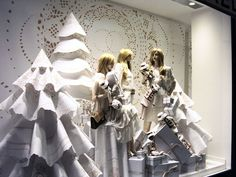 CHANEL | They celebrated the doily motif in a big way by exploding the shape in their backdrop. The all white Christmas trend appears to be carrying forward into 2013. #windowdisplay #visualmerchandising