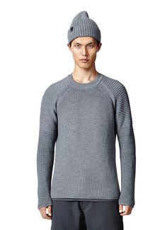 Inspired by the sweaters historically worn by fishermen, this heavyweight knit merino sweater offers an iconic shape with the performance capabilities merino is known for.   Features  Made in USA Yarn from Italy 100% Merino Wool    Size & Fit This piece runs true to size. The center back length is 27