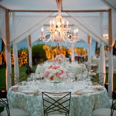 After the sun set, crystal chandeliers illuminated the reception tent, creating an intimate and sophisticated ambiance.  (Four Seasons Resort Maui at Wailea)