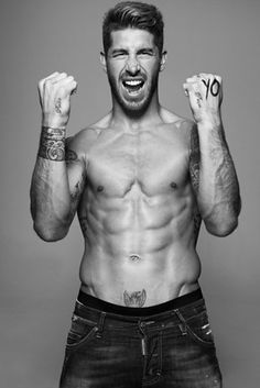 Spain: Sergio Ramos  Yes, the entire Spanish team is hot. But Sergio isn't just a pretty face. He also has pretty hair and pretty muscles and a pretty beard and a pretty tattoo just above his pubes.
