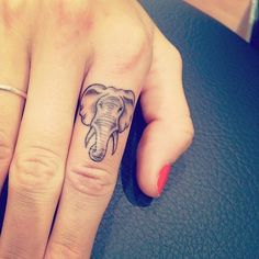 Elephant index finger tattoo.