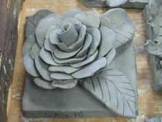 4th grade ceramic flower sculpture greenware; art teacher: Susan Joe