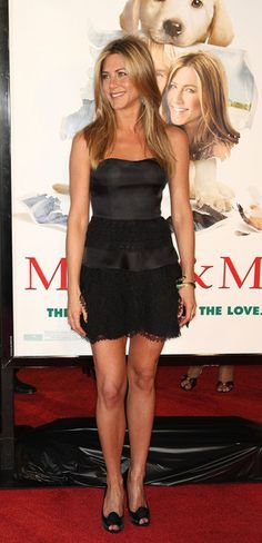 "Jennifer Aniston Strapless Dress - Jenn wore a hot black frock to the LA premiere of ""Marley & Me."" The strapless dress featured a sweetheart neckline and a tiered skirt."