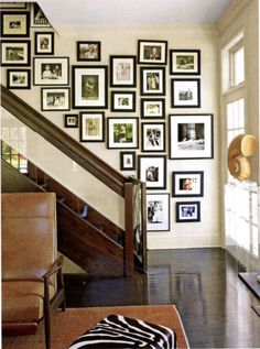 Bonnie Edelman relaxed an impressive photo display by hanging it tightly knit & semi straight. @housebeautiful