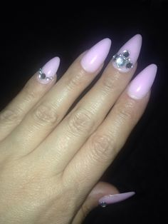 Pink acrylic almond nails with rhinestones