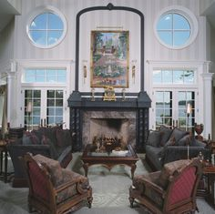 Windows look like artwork framing the fireplace