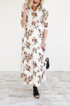 "White Maxi Dress  Mauve + Pink Floral Bouquet Print  3/4 Sleeve  Gathered Waist + Hip Pockets  Flowing Fit  Model is 5'6"" + Wearing a Small"
