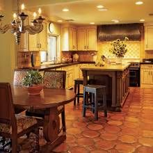 Saltillo flooring in this Southwest kitchen has a glossy sheen and blends octagons with smaller squares turned on a diagonal.
