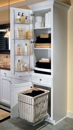 linen closet with removable hamper. probably wanna do this in the linen closet in master bathroom Bathroom Renos, Laundry In Bathroom, Bathroom Ideas, Bathroom Closet, Bathroom Renovations, Budget Bathroom, Bathroom Vanities, Tall Bathroom Cabinets, Bath Ideas