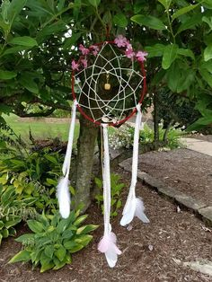 Check out this item in my Etsy shop https://www.etsy.com/listing/532320634/handcrafted-floral-dreamcatcher-with