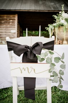 Cute bride and groom signage for the chairs.View the full wedding here: http://thedailywedding.com/2016/07/16/romantic-barn-wedding-inspiration/