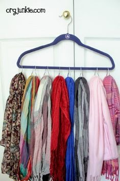 scarves organizer: I  bought 2 extra large hangers at Target and 5 packs of shower curtain rings and 2 over-the-door hooks at Dollar Tree and were able to hang all 60 scarves! Hooray! :-)