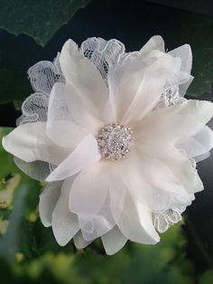 Bridal hair flower with lace and rhinestones by One World Designs Bridal Jewelry