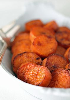 Simple Roasted Sweet Potatoes  serves 6    3 pounds red-skinned sweet potatoes (about 6 medium), trimmed, peeled, rinsed and cut into 3/4-inch thick rounds  2 Tablespoons vegetable oil  1 1/4 teaspoons kosher salt  pinch of granulated sugar