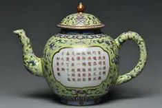 A QING DYNASTY INSCRIBED TEAPOT JIAQING MARK